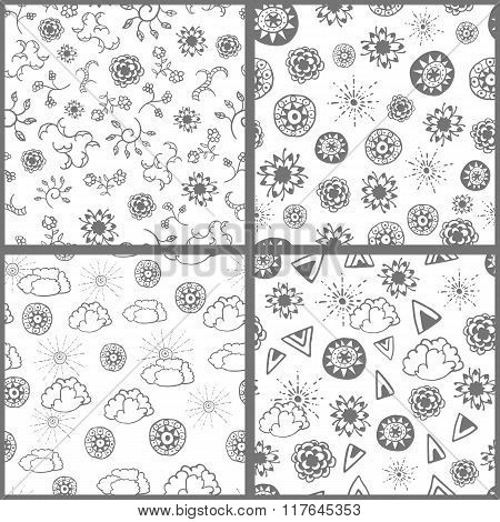 Set of four seamless patterns with hand drawn doodle elements