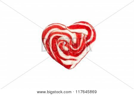 Candies in the form of red hearts on a white background