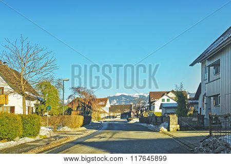 Road View to a village Switzerland in winter. Switzerland is a country in Europe. Switzerland has a high mountain range; from the Alps to Jura mountains.