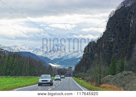 Road view to castle and mountains in Switzerland in winter. Switzerland is a country in Europe. Switzerland has a high mountain range from the Alps to Jura mountains. ** Note: Soft Focus at 100%, best at smaller sizes