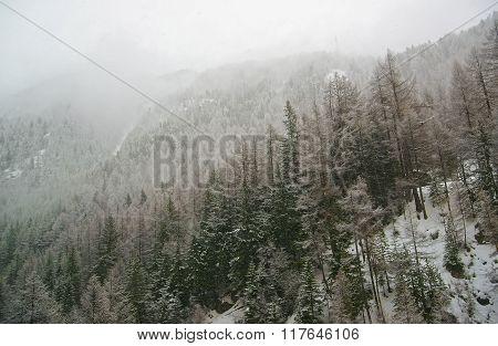 Snow covered Zermatt and fog in Switzerland in winter. Zermatt is a municipality in Visp district of the canton Valais.