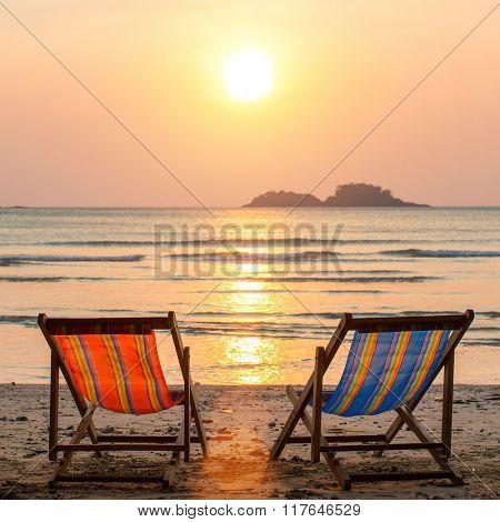 Couple of loungers on sea beach.