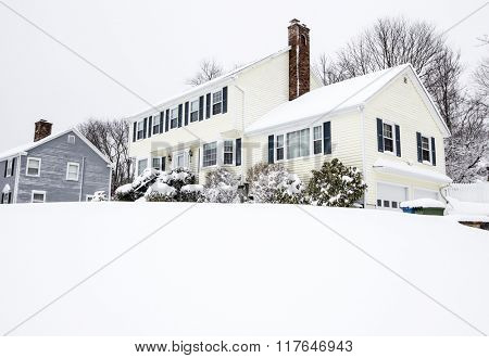 Traditional American colonial style house in winter