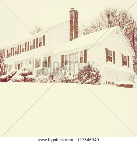 Traditional American colonial style house in winter with sepia tone