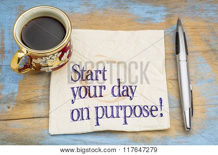 Start your day on purpose! A motivational advice or reminder on a napkin with a cup of coffee
