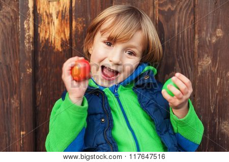 Cute little boy playing with easter eggs, egg hunting