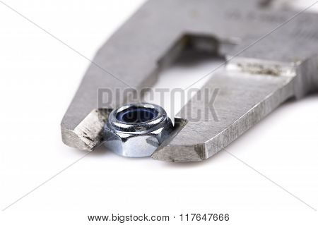 caliper and nut closeup isolated on white background