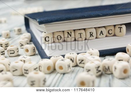 contract word written on wood block. wooden ABC
