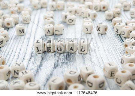 LEGAL word written on wood block. Wooden ABC.