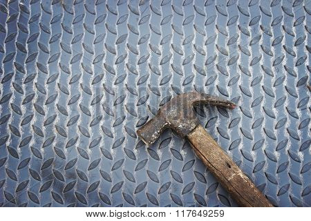 Hammer On Metal With Grunge Background