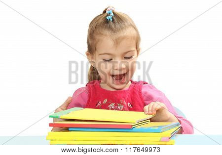 The Little Girl With Books At A Table