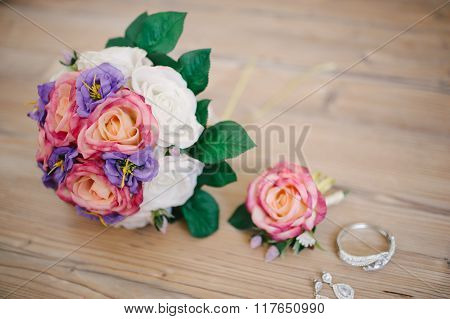 Bride's Necklace And Earrings And Bouquet