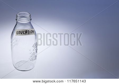 empty jar labeled with education