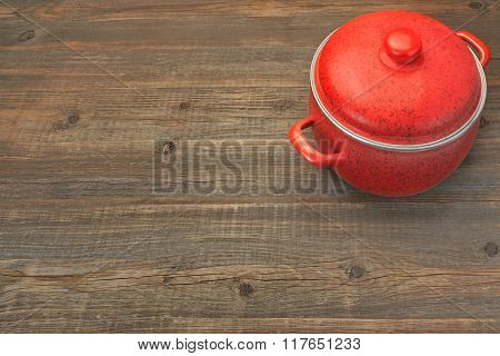 Covered Red Saucepan On The Rustic Brown Wood Background, Overhead