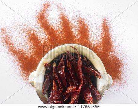 dry chili in mortar with chili powder form fire shape