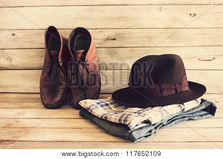 Vintage,plaid Shirt,hat,bag,jean And Leather Shoes On Wood Background