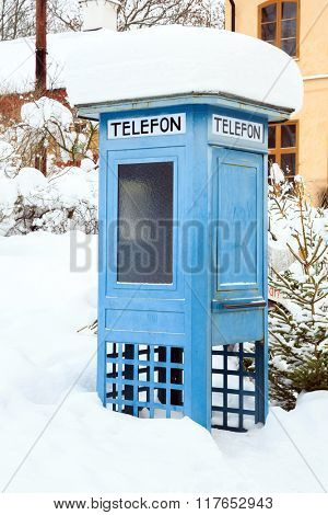 Blue Telephone Booth with snow in Stockholm Sweden