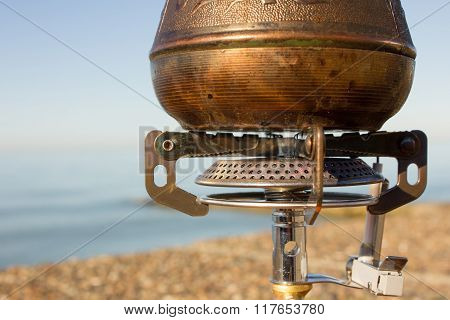 Turk with coffee on a gas burner
