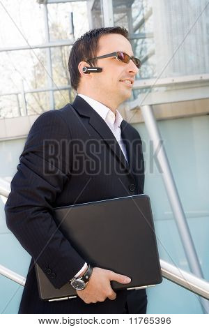 Satisfied businessman with laptop