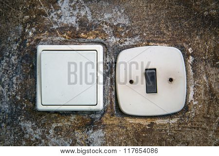 two abstract electric switches on wall