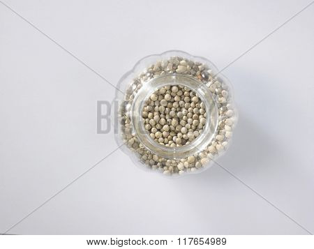 peppercorn in a glass container