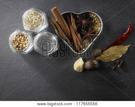 top view of assorted spices some in heart shape container