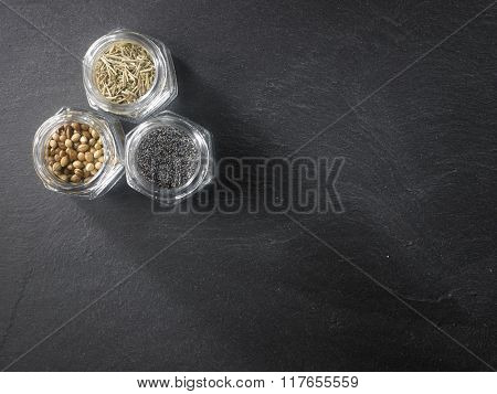 top view of assorted spices on the black slate