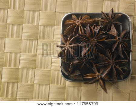 anise star in a square container