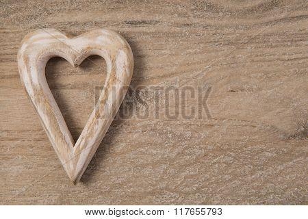 Wooden hart on wood