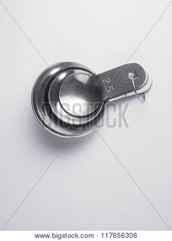stainless steel measuring spoon on white background