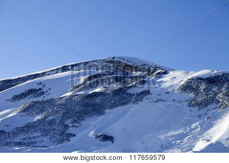 Snowy Mountains With Track From Avalanche After Snowfall