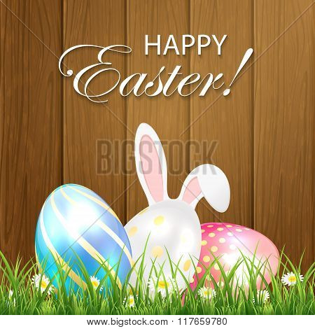 Easter Background With Shiny Eggs And Rabbit On Wooden Background