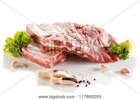 Raw pork ribs on white background