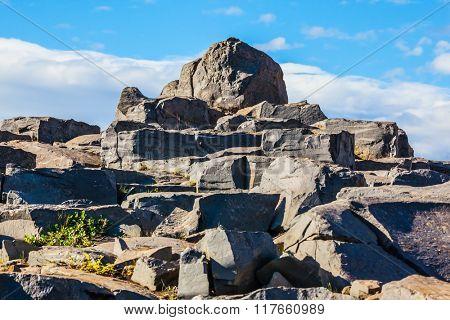 Huge stones on the plateau near a waterfall Dettifoss.  Iceland, Jokulsargljufur National Park