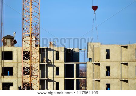 Industrial Work At Construction Site - Crane Moving The Concrete Panel Slab On Building Slings.