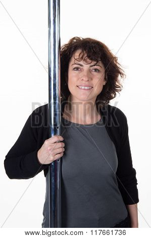 Woman Near The Pole, Waiting For The First Training Pole Dancer