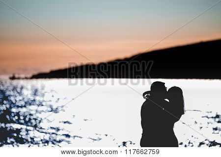 Silhouette of a couple in love on the beach at sunset.Love story.Man and a woman on the beach