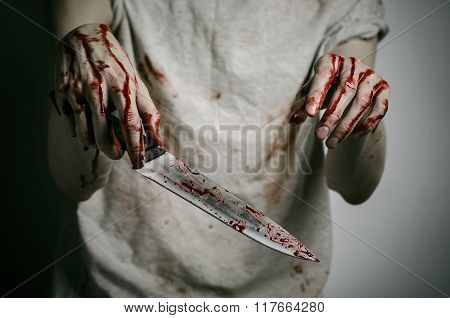 Blood And Halloween Theme: Man Holding A Bloody Knife In His Hand, A Bloody Murderer