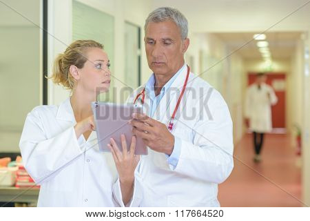 Two doctors conferring