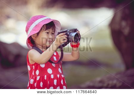 Asian Girl Photographer With Professional Digital Camera In Beautiful Outdoors.