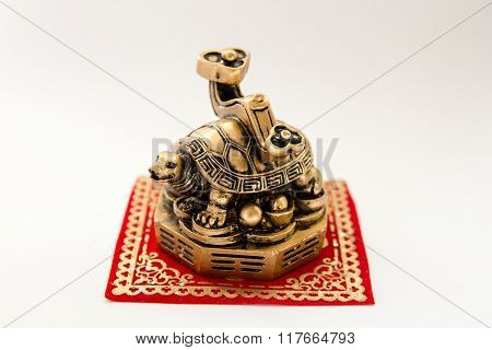 Symbol Of A Turtle Figurine On A White Background , Feng Shui