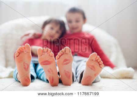 Little Kids Feet, Covered With Prints From Kisses