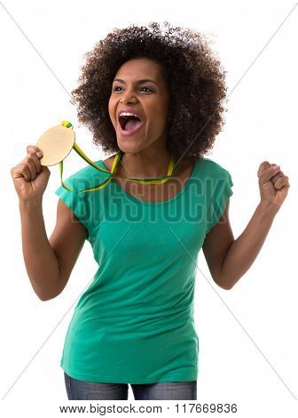 Brazilian woman holding a gold medal on white background