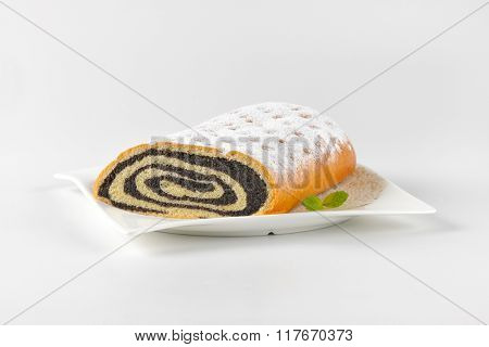 poppy seed roll on white square plate