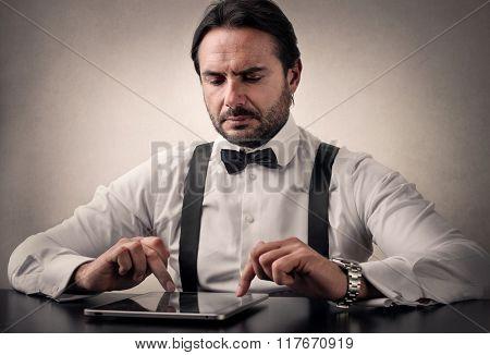 Gentleman using a tablet