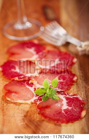 antipasti Platter of Cured Meat  jamon and wine, closeup