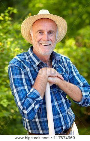 Happy Senior Gardener With Straw Hat