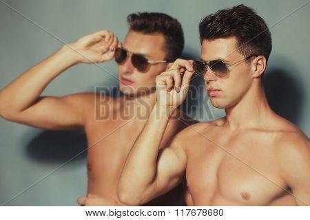 Two boys posing in studio