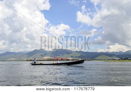 INLE LAKE, MYANMAR - NOVEMBER 02: Tourists take part in a boat trip on November 2, 2015 on Inle Lake, Myanmar (BURMA). It is famous place for the tourism to visit Inle lake
