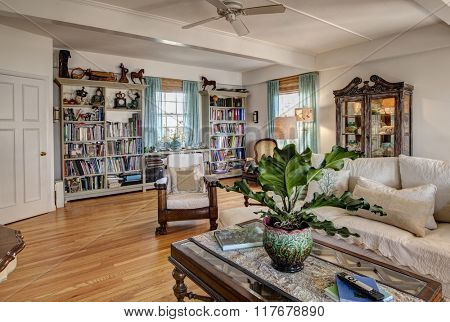 Home library with bookshelves and furniture